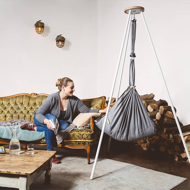 Swinging hammock with Tipi stand in the living room