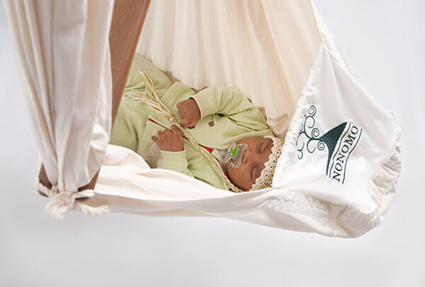Baby sleeps peacefully in the old version of the swinging hammock